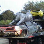 """I put a Giant Aluminum Cow on your car! April Fools!"""