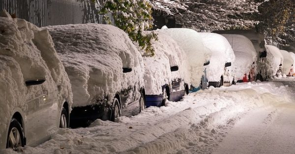 cars covered in winter snow