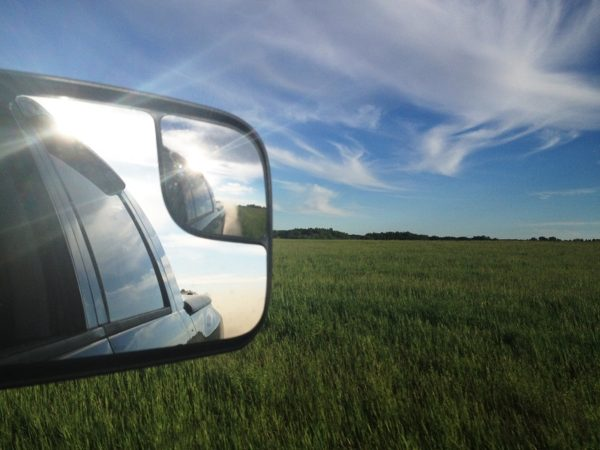tow mirror attached to pickup sunny day