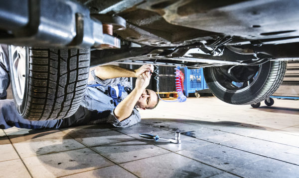 mechanic underneath car for repair
