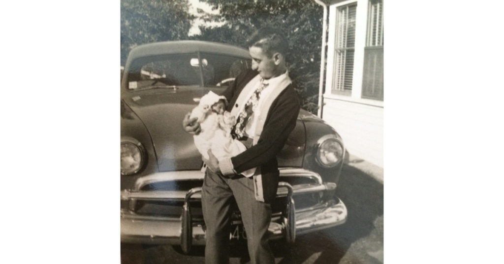 old photo of father holding son