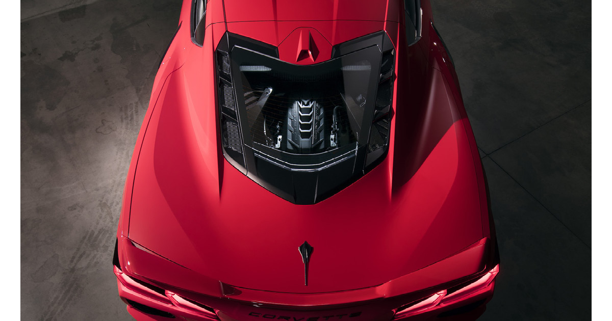 The new 2020 Chevy Corvette Stingray features a mid-engine design. The engine is visible thanks to a transparent cover.