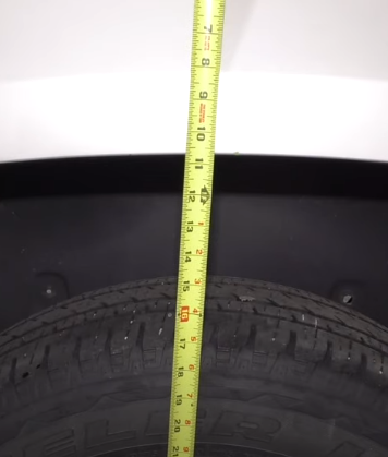 Measuring tape against the outer fender - testing air suspension kit