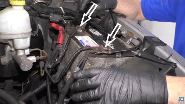 Make sure your battery is working, as our mechanic does in this photo.