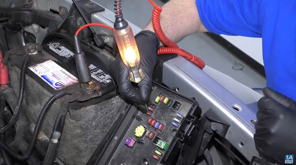 Your test light lights up when you test your starter, you should check your fuses next, as our mechanic does in this photo.