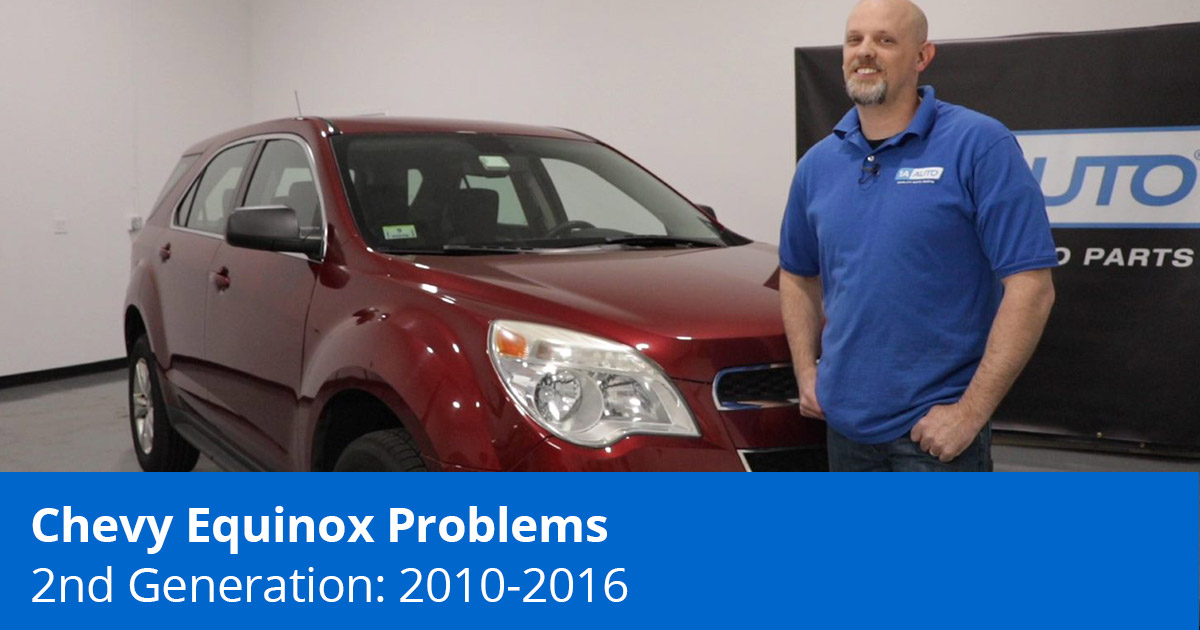 Mechanic standing in front of Chevy Equinox showing top problems
