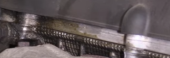 Engine oil stains from a bad valve cover gasket