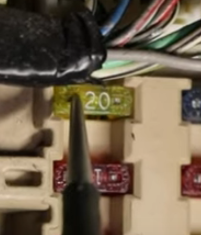 Test light probing a fuse