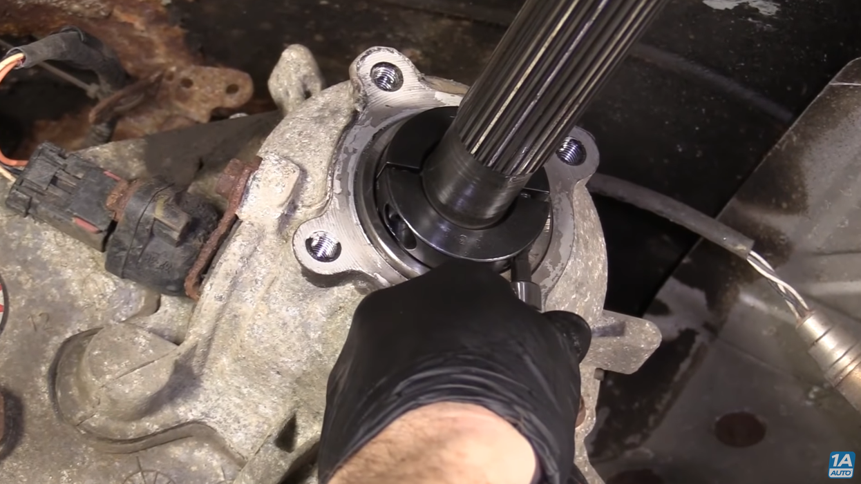 Sliding in a new snap ring to fix transfer case problems