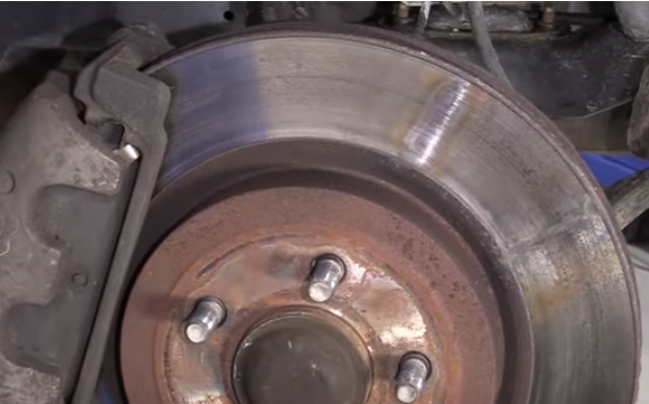 Brake rotor scored with hot spots at the 1 and 2 o'clock position
