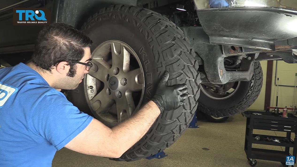 Mechanic Looking through the rim