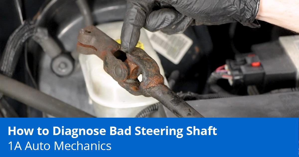 Mechanic diagnosing clunking noise when turning