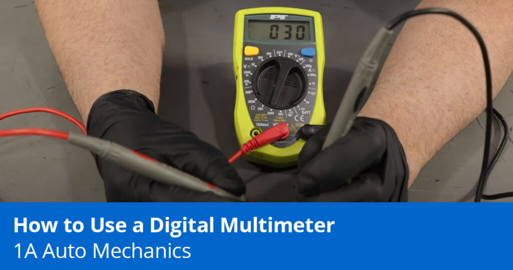 Picture of mechanic using a digital multimeter