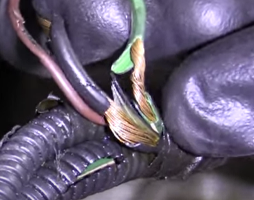 Exposed copper wire with broken protective sheath