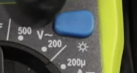 Alternating current (A/C) voltage symbol (marked with a V and a tilde) on a digital multimeter