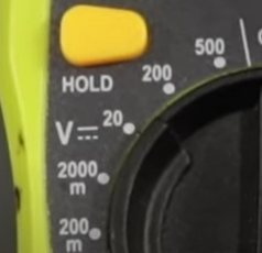 Direct current (D/C) voltage icon (marked with a V and two parallels lines with a lower dotted line) on a digital multimeter