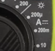 Amperage icon (marked with an A and two parallels lines with a lower dotted line) on a digital multimeter