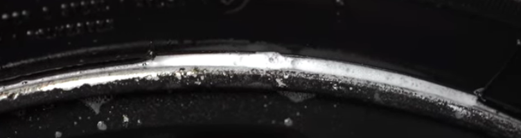 Tire seal leak indicated by sudsy bubbles