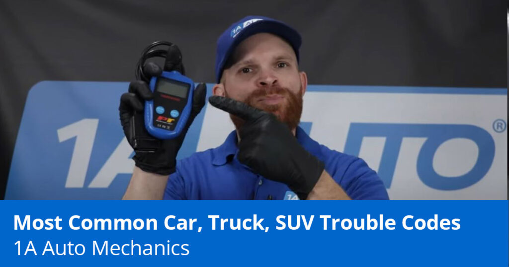 Mechanic explaining common trouble codes