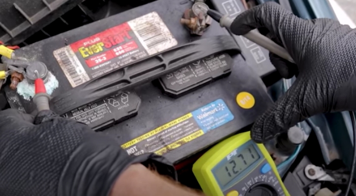Testing battery voltage with a multimeter while jumpstarting a car