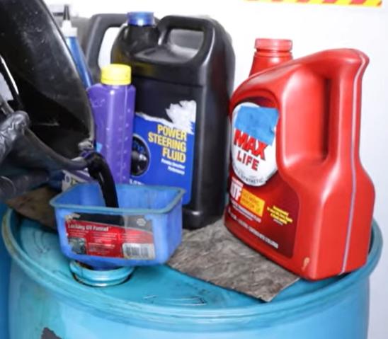 Disposing waste motor oil into a waste oil jug