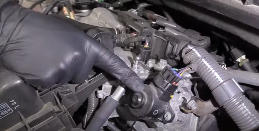 Mechanic showing EGR valge problem which is a top 5 toyota prius problem
