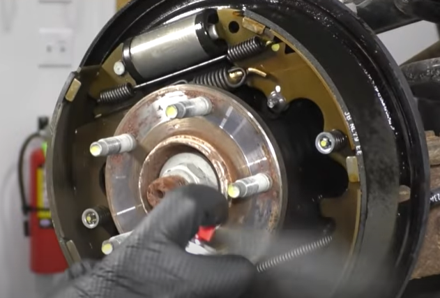Cleaning a brake drum with brake parts cleaner