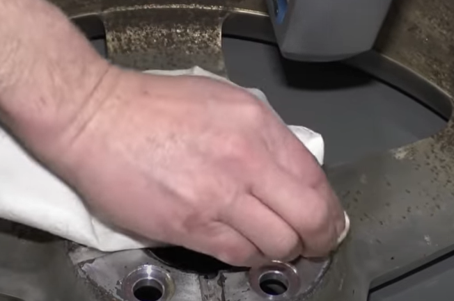 Applying motor oil to a wheel to prevent the tire from getting stuck