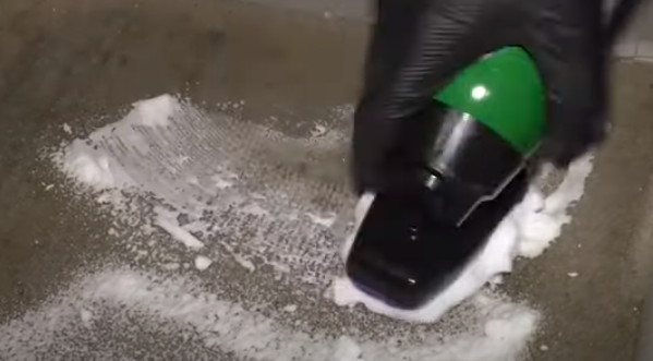Cleaning the carpet with carpet shampoo