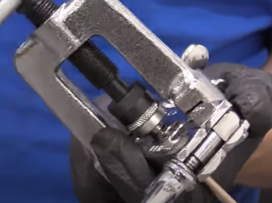 Bubble flaring a brake line with a flare bar and yoke press tool