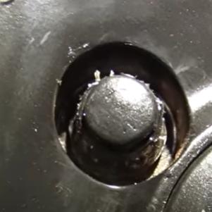 Spinning and frayed lug nut cap