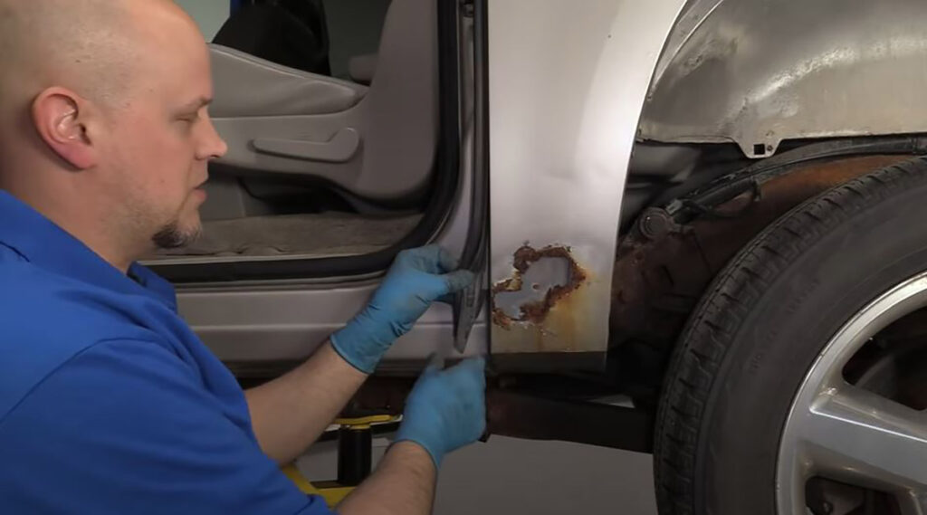 Mechanic showing how to fix rust holes on your car