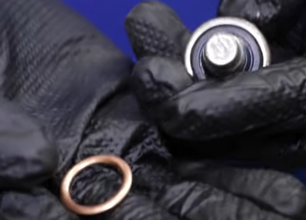 Oil drain plug metal gasket and an oil drain plug with a rubber gasket attached